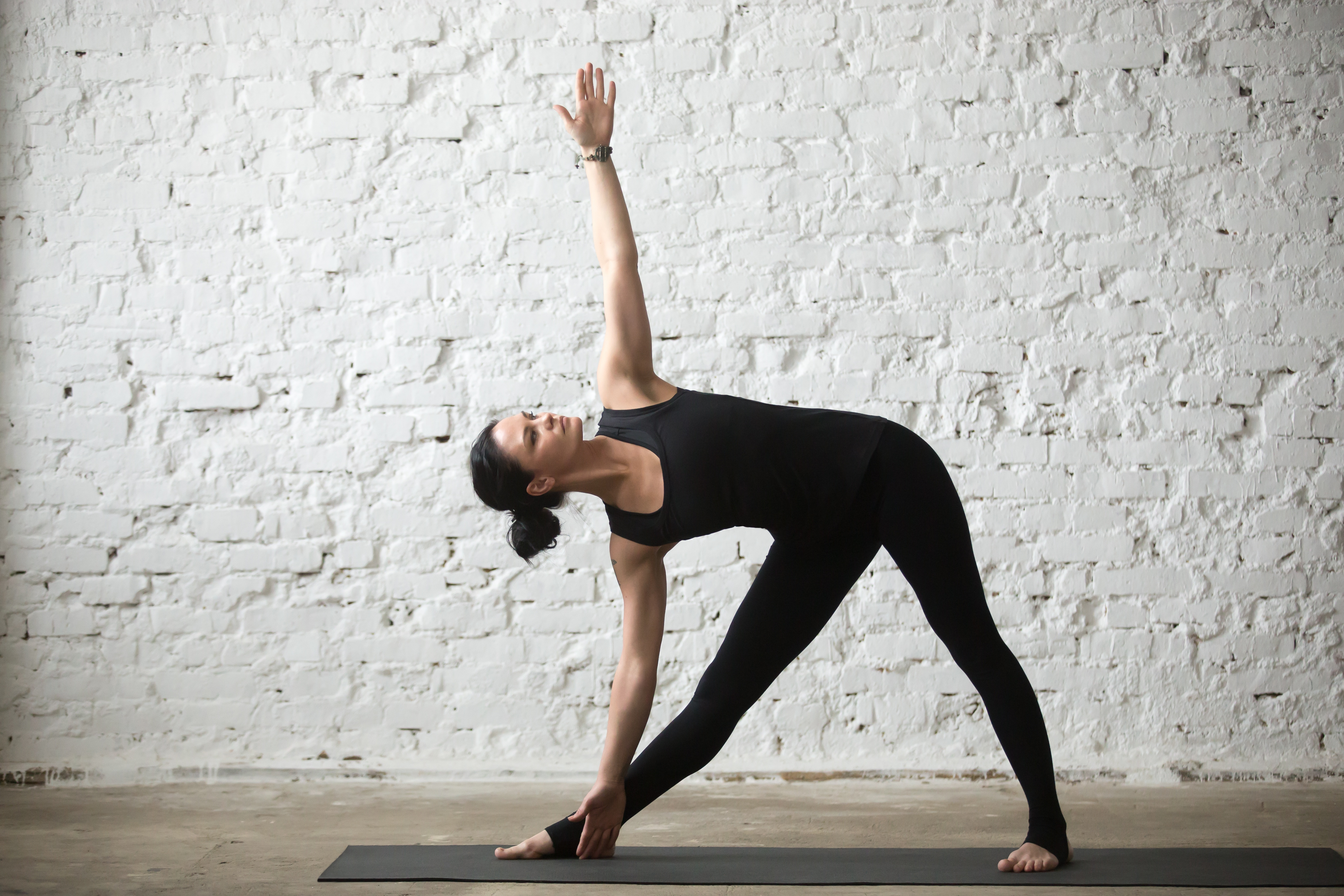 6 Yoga Poses to try for Back Pain - Triangle Pose