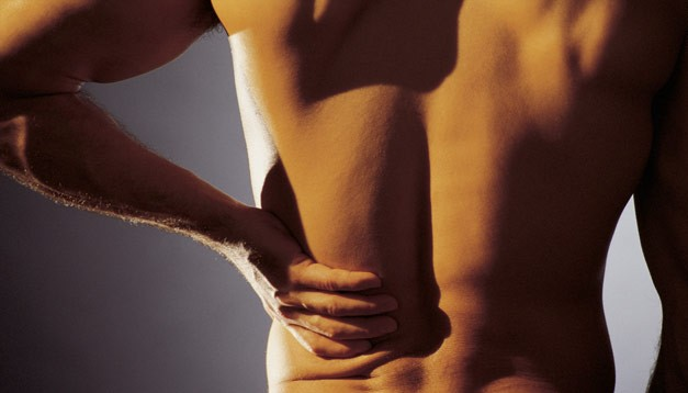 treating lower back injuries and pain: symptoms, causes, and solutions
